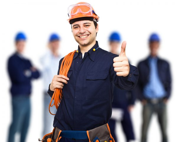 Portrait of an happy worker in front of his team
